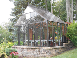 Freestanding garden greenhouses